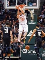 New York Knicks center Enes Kanter (00) dunks the ball between Milwaukee Bucks forward John Henson (31) and forward Jabari Parker (12) in the third quarter at the BMO Harris Bradley Center on Friday, Feb. 2, 2018.