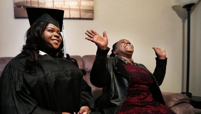 Annie Ivory, 52, (right) talks about what it means to have earned her diploma as she and her daughter Pearlina Ivory (left) get ready for the University of Memphis Winter Commencement at the Crescent Bluff Apartments Sunday afternoon. After decades of attending college while working and raising children Annie finally got her bachelor's degree on the same day her daughter earned a bachelor's degree in education.
