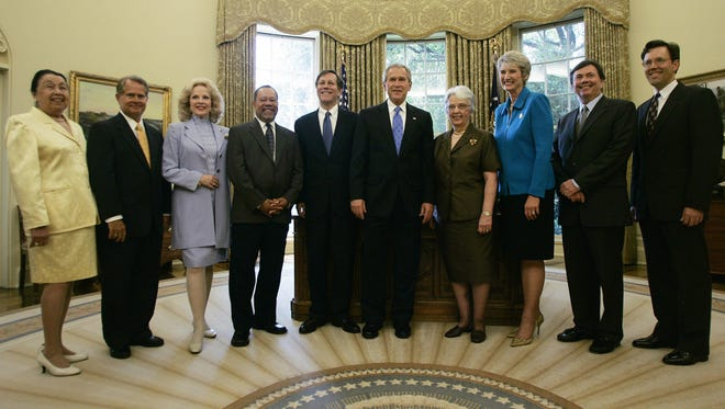 President George W. Bush, center, poses with members of the National Council on the Arts in the Oval Office of the White House 11 July 2006 in Washington, DC. The National Foundation on the Arts and Humanities Act of 1965 established the National Endowment for the Arts and provided for 26 citizens to serve as advisors to the agency as members of the National Council on the Arts.