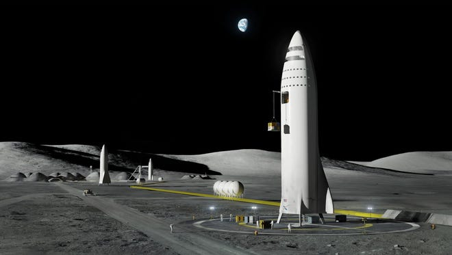 This artist's rendering made available by Elon Musk on Friday shows SpaceX's new mega-rocket design on the Earth's moon. With the 350-foot-tall spacecraft, Musk announced that his private space company aims to launch two cargo missions to Mars in 2022.
