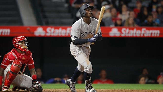 New York Yankees' Didi Gregorius watches his home run during the 10th inning of a baseball game against the Los Angeles Angels, Friday, April 27, 2018, in Anaheim, Calif.