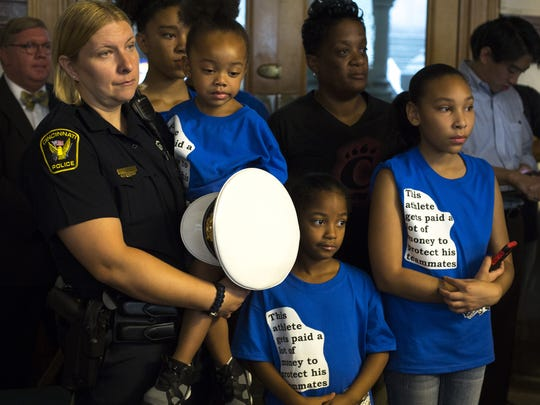 Cincinnati Police Officer Charlene Hahn (left) her wife, Anna, and their children (from left) Shabari, 3, Aliyah, 7, and Trinity, 12, attend City Council's budget committee meeting earlier this month in support of Mayor John Cranley's proposed pay increases for most city employees.