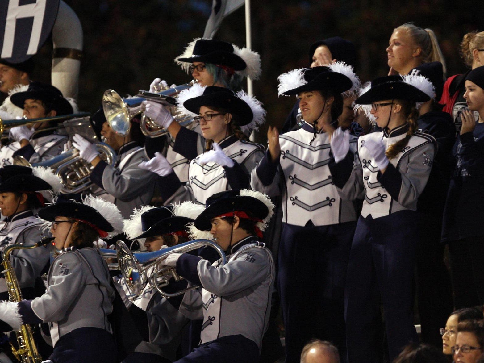 The Howell band plays as their team plays Freehold Township in a football game Friday, September 25, 2015, at Howell High School.