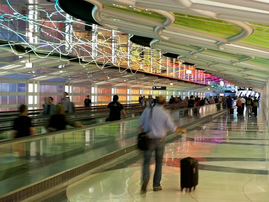 635706544578135716-CHICAGO-The-Sky-s-the-Limit-Neon-sculpture-in-walkway-between-ORD-Terminal-1-Concourses-B-and-C.