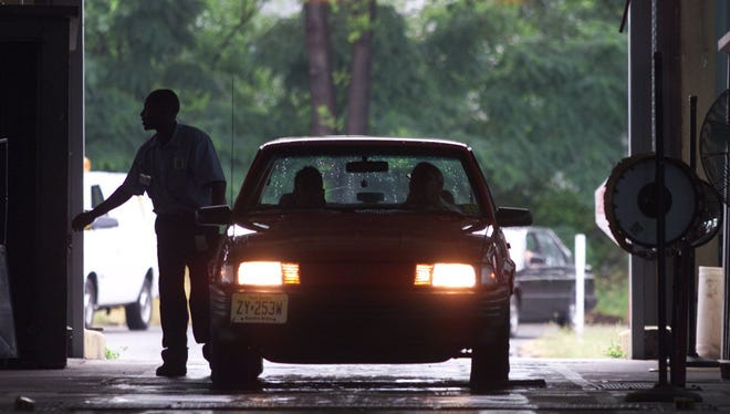 Motorists make their way through the Rahway State Inspection Center, Thursday July 1, 1999.