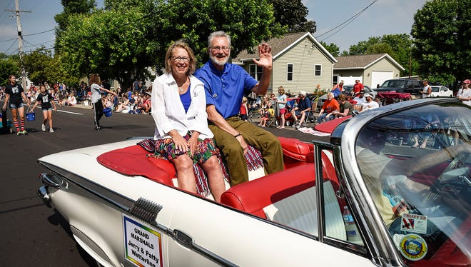 Grand Marshals Patty and Jerry Wetterling wave to the crowd along the Church of St. Joseph Parish Festival parade route Tuesday, July 4, in St. Joseph. The Wetterlings were easily top pick of readers for 2016 Difference Makers. Would you select them again in 2017?