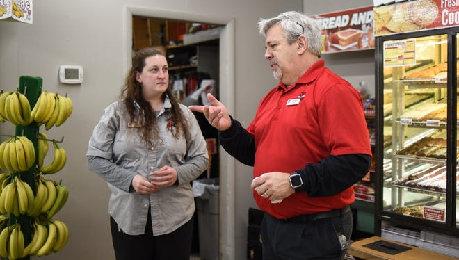 """Quality Dairy Chief Operating Officer Jeff Schook chats with store manager Kira Timmins while working a morning shift at the store on Lansing Road in Dimondale Thursday morning, March 1, 2018.  It is part of QD's """"Who's the Boss,"""" where leadership works a shift at each of their 30 locations."""