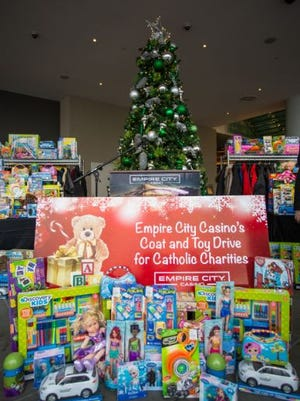 Empire City's annual toy drive collected about 1,000 toys and coats for Catholic Charities.