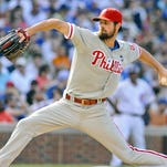 Philadelphia Phillies' starting pitcher Cole Hamels delivers during the seventh inning against the Chicago Cubs.