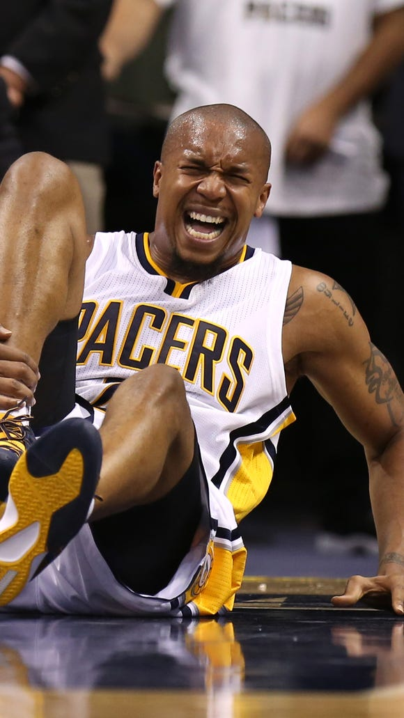 Indiana Pacers' David West, shown here in pain against the Dallas Mavericks on Oct. 18, is hoping to play for the first time this season on Friday.