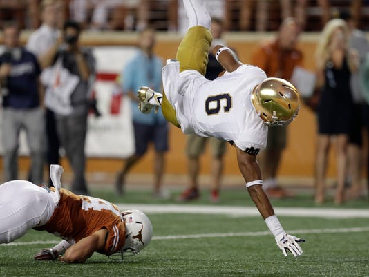 Notre Dame wide receiver Equanimeous St. Brown (6) is upended by Texas safety Dylan Haines, left, as he sails into the end zone for a touchdown during the first half of an NCAA college football game, Sunday, Sept. 4, 2016, in Austin, Texas. (AP Photo/Eric Gay)