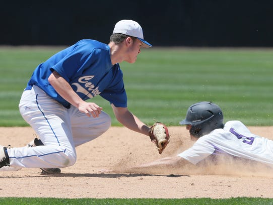 Carteret's Michael App (17), left, gets the out on