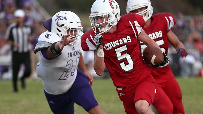 Christoval's Seth Parker breaks away from Irion County's defense during their season opener in 2016.