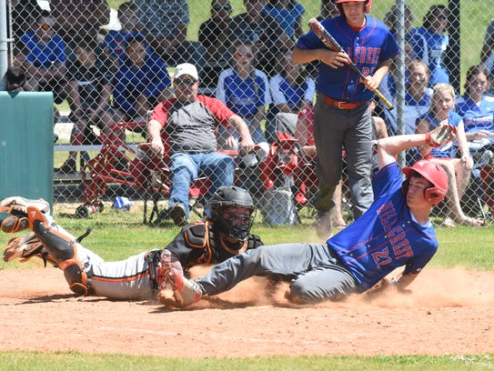 Hillcrest's Kord Woodard (21) steals home plate for