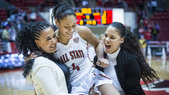 photos by Jordan Kartholl/The Star Press Ball State's Nathalie Fontaine is joined by her mother and sister who try (and fail) to carry her after Fontaine broke the school's all-time scoring record during their game against Northern Illinois on Wednesday. Ball State's Nathalie Fontaine is joined by her mother and sister who try (and fail) to carry her after Fontaine broke the school's all-time scoring record during their game against Northern Illinois Wednesday, March 2, 2016.