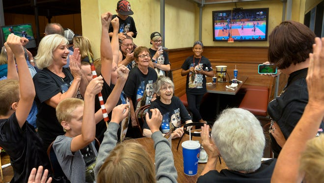 Family and friends cheer at Zaffiro's as U.S. Olympic BMX hopeful Alise Post captures the silver medal in the finals Friday, Aug. 19, 2016. The group ended up watching the event on Heather Post's cellphone after technical difficulties kept the event from being shown on Marcus Parkwood Cinema theater screens.