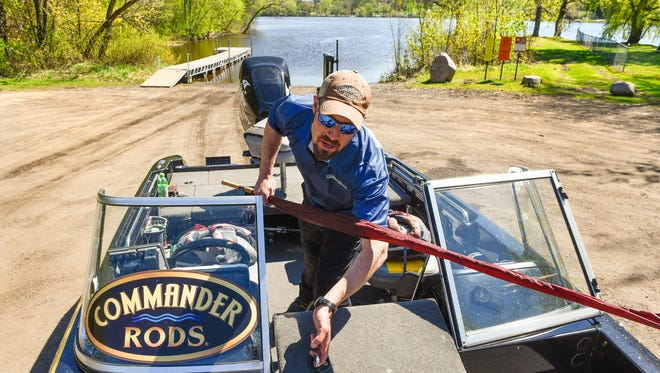Fishing guide Doug Hanson packs his boat after making a final pass on water levels and temperatures Thursday, May 11, where the Governor will fish for the opener. Hanson will be in the boat with host Todd Bissett with Gov. Mark Dayton on the Mississippi River Saturday. This is Hanson's seventh Governor's Fishing Opener but the first time with the Governor.