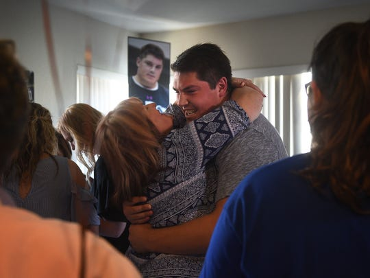 Austin Corbett hugs his mother Melissa following the