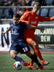 Indy Eleven midfielder Ben Speas (19) takes the ball from Puerto Rico FC forward Conor Doyle (8) in the first half of their NASL soccer match Saturday, April 1, 2017, afternoon at Carroll Stadium on the campus of IUPUI.