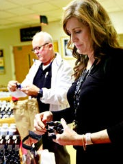 Pam Workman, front, of Conewago Township, and Fred Valentin, of Stewartstown, look at natural oil blends after attending a lecture given by Dr. Cass Ingram, D.O., about curing oneself naturally, during a free seminar at Sacred Heart Parish Center in Spring Grove, Wednesday, Oct. 25, 2017. Both sufffer from chronic pain and fatigue, as well as other symptoms associated with lyme disease.  Dawn J. Sagert photo