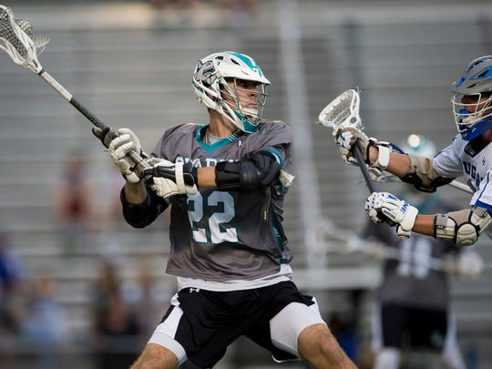 Gulf Coast's Luke Curran (22) fires a shot off in the first half against Barron Collier of a first-round play-in game at Barron Collier High School Thursday, April 13, 2017 in Naples. Barron Collier led 5-4 at the half.