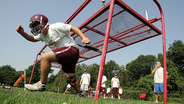 Harrison's center nose guard Duke Alvora during a football team work out on the first day of practice at the high school in Harrison Aug. 20, 2010. ( Matthew Brown / The Journal News )