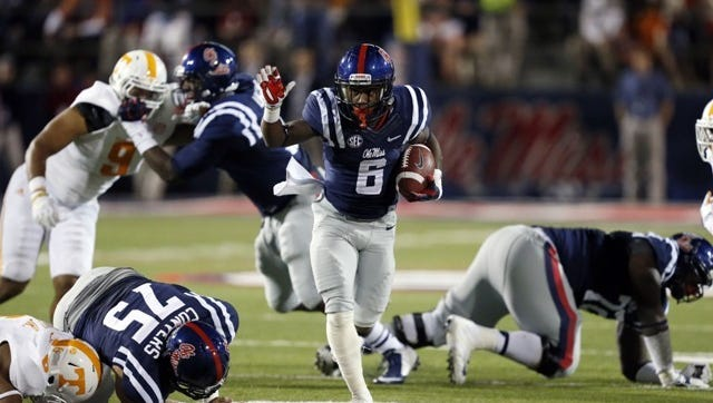 Ole Miss running back Jaylen Walton runs through an open backfield against Tennessee earlier this season.