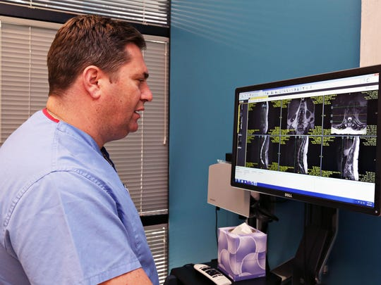 Dr. Daniel Lieberman, MD, in his new new Phoenix Spine Surgery Center, with a computer that he uses to examine patient's MRI's to determine a course of treatment as seen in Goodyear on June 2, 2015.