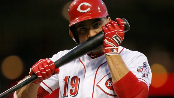 Reds first baseman Joey Votto raises his bat to his nose between pitches in the bottom of the fifth inning against the Cleveland Indians at Great American Ball Park on Tuesday, May 23. Despite a comeback, four-run seventh inning, the Reds fell 8-7 to the Indians.