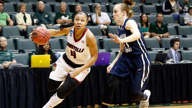 Louisville Cardinals forward Mariya Moore (4) controls the ball against Brigham Young Cougars guard Lexi Eaton (21) during the first half of an NCAA women's college basketball tournament game, Saturday, March 21, 2015, in Tampa, Fla. (AP Photo/Brian Blanco)