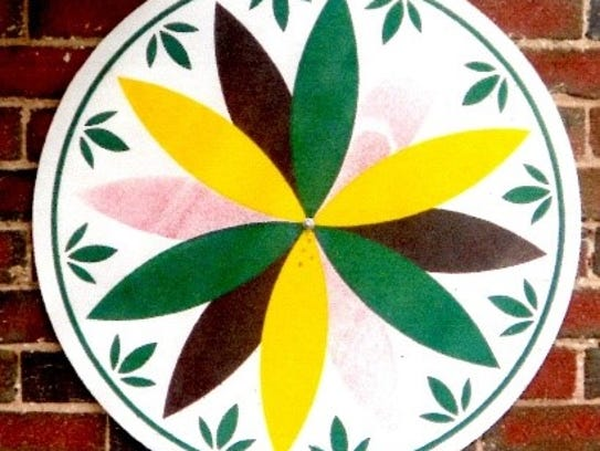 This simple 12-pointed, multicolored rosette symbolizes