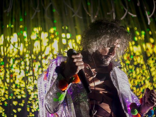 Wayne Coyne of the Flaming Lips performing at the Arizona