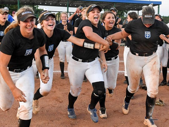 Christian Academy of Knoxville softball seniors Allison Zimmerman (3), Cassidy Heemsoth (7), Lexi Harmon (12), Paige Simpson (5), and Emma Webb (10) run out to receive their 2017 TSSAA Class AA State Girls' Softball championship trophy, Friday, May 26, 2017.