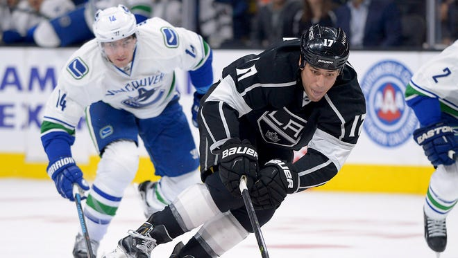 Los Angeles Kings left wing Milan Lucic (17) chases down the puck in the second period of the game against the Vancouver Canucks at Staples Center.