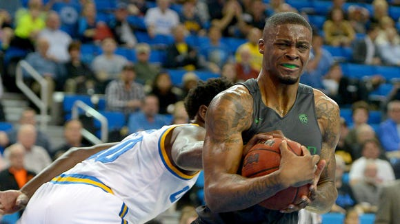 Mar 2, 2016; Los Angeles, CA, USA; Oregon Ducks forward Elgin Cook (23) is fouled by UCLA Bruins guard Isaac Hamilton (10) in the first half of the game at Pauley Pavilion. Mandatory Credit: Jayne Kamin-Oncea-USA TODAY Sports