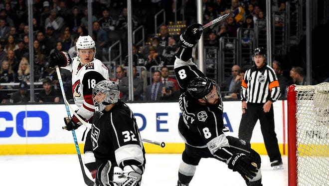 Apr 2, 2017; Los Angeles, CA, USA;  A goal by Arizona Coyotes center Christian Dvorak (18) past Los Angeles Kings defenseman Drew Doughty (8) and goalie Jonathan Quick (32) was not allow because of off sides in the first period of the game at Staples Center. Mandatory Credit: Jayne Kamin-Oncea-USA TODAY Sports