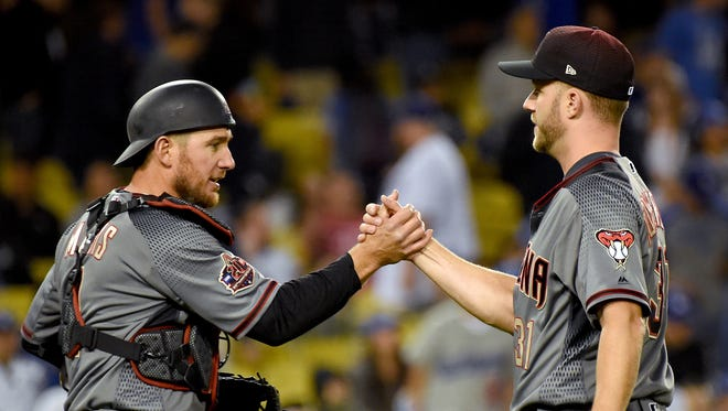 Apr 13, 2018; Los Angeles, CA, USA;  Arizona Diamondbacks relief pitcher Brad Boxberger (31) shakes hands with Arizona Diamondbacks catcher Jeff Mathis (2) after a save in the ninth inning against the Los Angeles Dodgers  at Dodger Stadium.