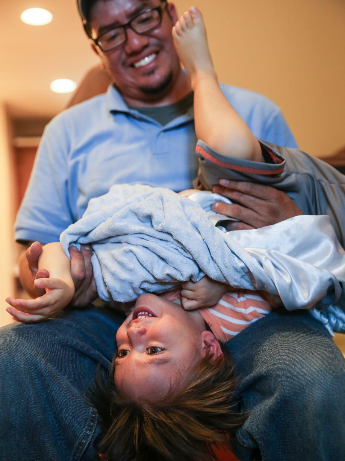 Nathan Lopez flips his son, Aiden Lopez.