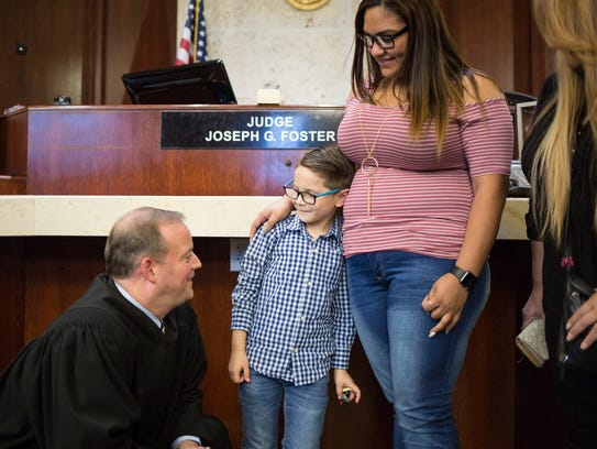 Judge Joseph G. Foster meets personally with 7-year-old