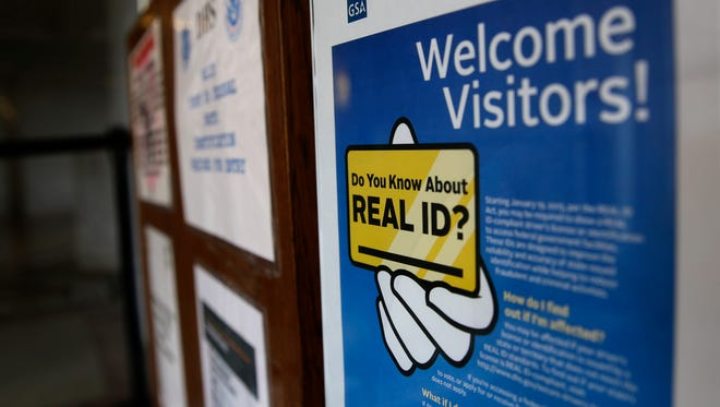 In this file photo from 2016, a sign at the federal courthouse in Tacoma, Washington, informs visitors of the federal government's REAL ID act, which requires state driver's licenses and ID cards to have security enhancements and be issued to people who can prove they're legally in the United States.
