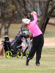 Big Spring's Abbey Bryan tees off during the final