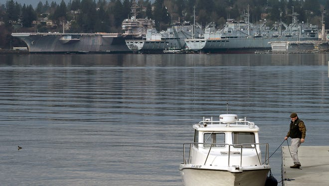 Bremerton's mothball fleet of ships from the Water Street Dock in downtown Port Orchard on Thursday.
