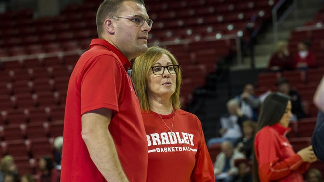 Bradley men's head basketball coach Brian Wardle and women's head coach Andrea Gorski meet on the court in Renaissance Coliseum before the start of the Red-White scrimmage last season. The 2020 version is slated for Nov. 14.