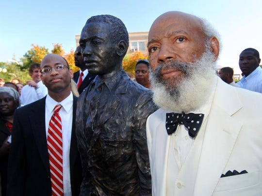 James Meredith, right, and his late son, Dr. Joseph Meredith, flank a bronze statue in the likeness of the elder Meredith, at the dedication of a civil rights memorial on the campus in Oxford, Miss., in October 2006.