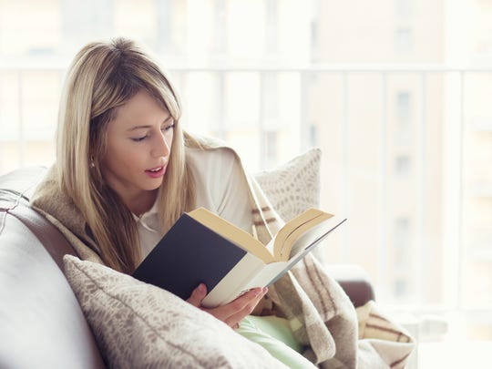 Women report more stress over the holidays than men. Take a moment to de-stress yourself, such as by reading a book.