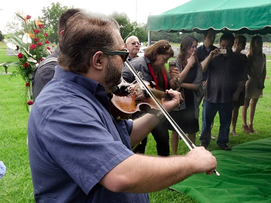 Musicians play Belton Richard's 'Paradis des Musiciens' at his burial in Lafayette Monday, June 26, 2017.