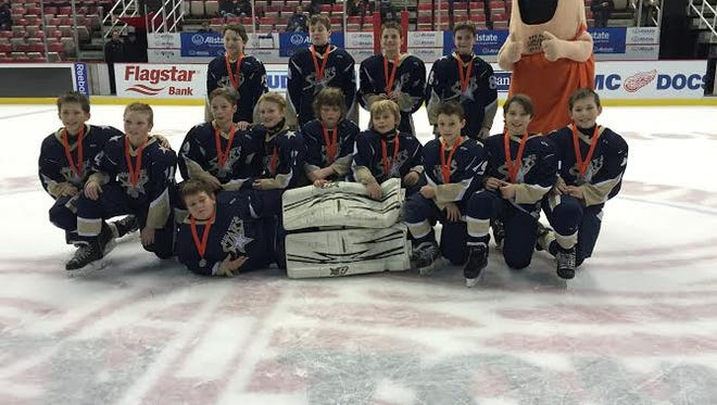 05 Blue Water Stars pose for a picture after playing at Joe Louis Arena.