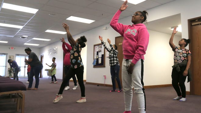 Various members from different dance groups rehearse in the Maddox Memorial Temple for the church's Easter program on Saturday. The program will include dramatic skits, gospel rap, mass choir and many other performance styles.