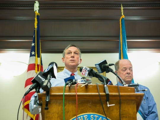 Gov. John Carney (left) and former U.S. Attorney Charles M. Oberly III hold a press conference to discuss the findings of the Department of Correction Independent Review's final report at the Carvel State Office Building in Wilmington.