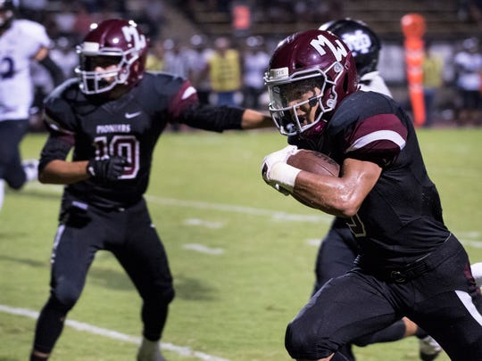Mt. Whitney's Mike McKernan runs for a touchdown against Mission Oak in a non-league high school football game on Friday, September 7, 2018.